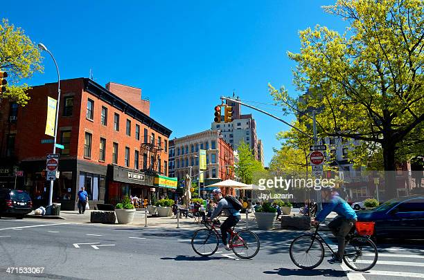 people at cafe tables, bicyclists, ft greene, brooklyn, nyc - fort greene stock pictures, royalty-free photos & images