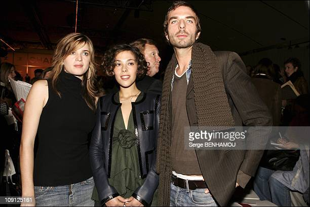 People At Chanel Spring Summer 2005 Ready To Wear Fashion Show In Paris On October 8 2004 In Paris France Cecile Cassel Alysson Paradis John Nollet
