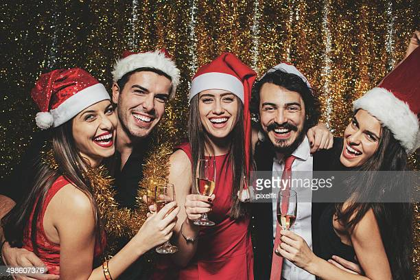 people at christmas party - christmas party stock photos and pictures