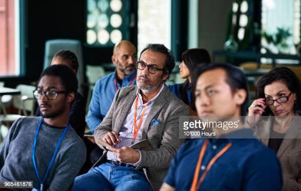 people at conference - publikum stock-fotos und bilder