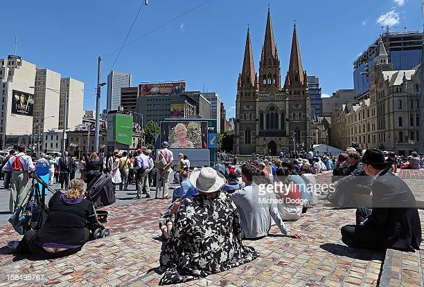 People at Federation Square watch the Dame Elisabeth Murdoch public memorial at St Paul's Cathedral on December 18 2012 in Melbourne Australia Dame...