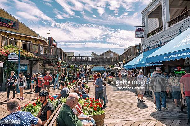 people at fisherman's wharf - pier 39 - fishermans wharf stock pictures, royalty-free photos & images