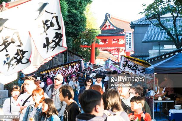 People at Fushimi Inari Taisha in Kyoto, Japan