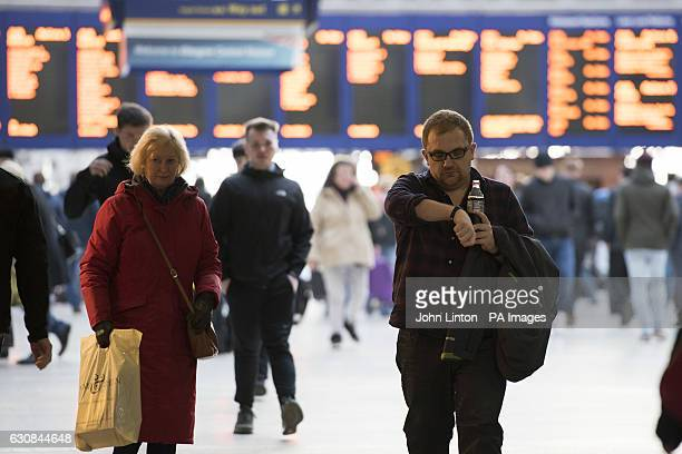 People at Glasgow Central railway station after the average rail fare increase across Britain of 2.3\% came into force on Monday.