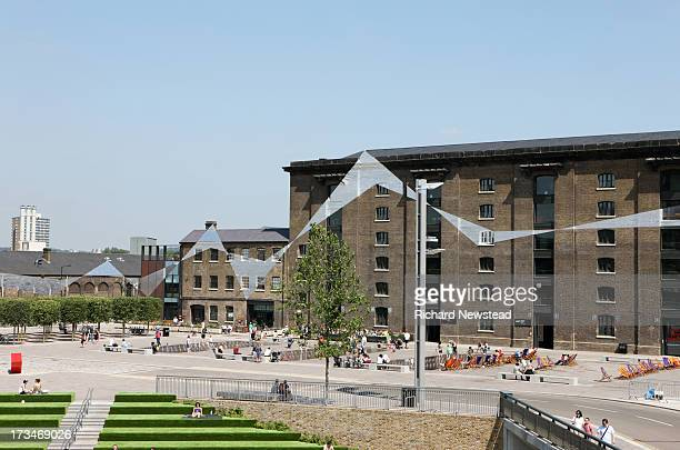 People at Granary Square in Kings Cross which includes the Central Saint Martins campus. London, July 7th 2013