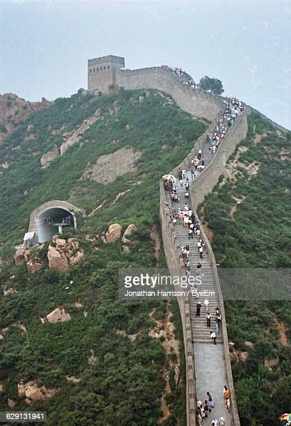 People At Great Wall Of China On Mountain