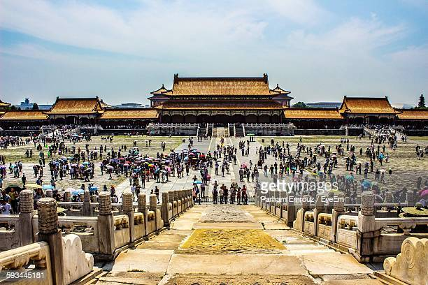 people at historic forbidden city against sky - parham emrouz stock pictures, royalty-free photos & images