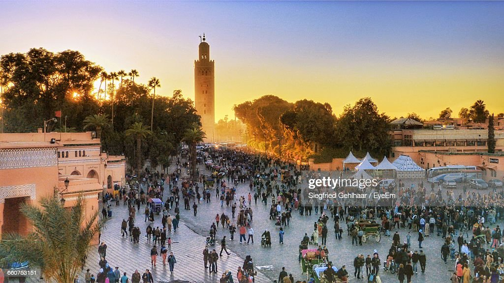 People At Jemaa El-Fnaa During Sunset : Stock Photo