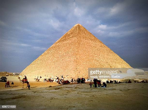 People At Kheops Pyramid Against Cloudy Sky
