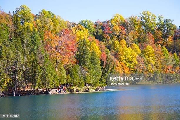 people at lakeside in fall, syracuse - syracuse new york stock pictures, royalty-free photos & images