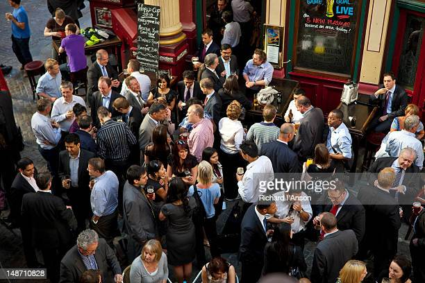 people at lamb tavern in leadenhall market. - crowded stock pictures, royalty-free photos & images