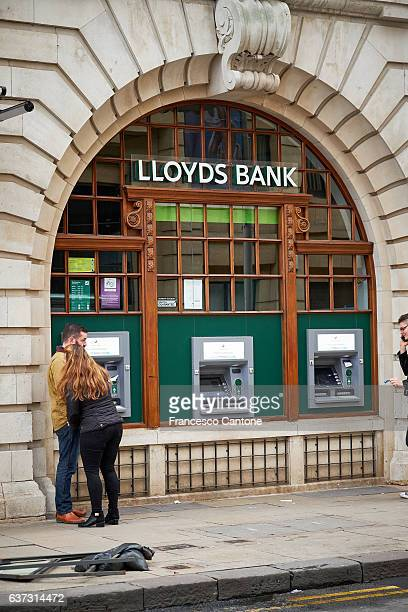 People at Lloyds bank atm, cash dispenser