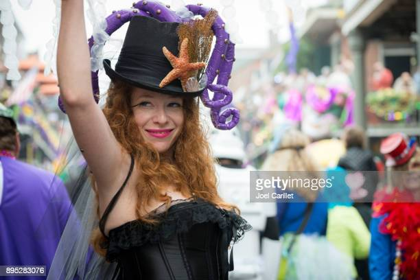 people at mardi gras in new orleans - new orleans mardi gras stock photos and pictures