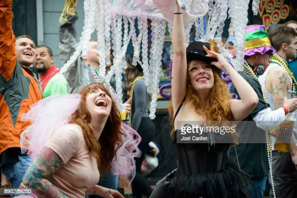 people at mardi gras in new orleans - mardi gras fun in new orleans stock photos and pictures