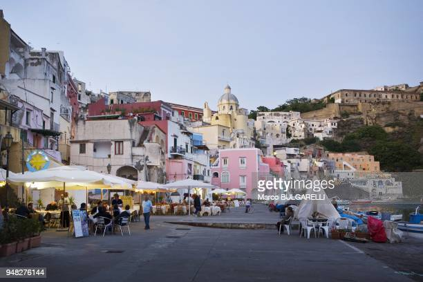 People at Marina di Corricella bars and restaurants on June 11 2012 in Procida Italy