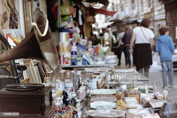 people at market stall - flea market stock pictures, royalty-free photos & images