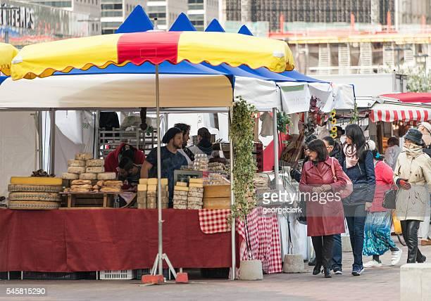 People at market stalls in La Defense, Paris