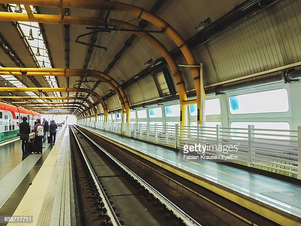 people at modern fiumicino aeroporto railway station - national landmark stock pictures, royalty-free photos & images