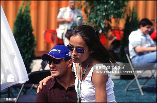 People at Montreal grand prix In Montreal Canada On June 16 2000Jean alesi and wife Goto Kumiko