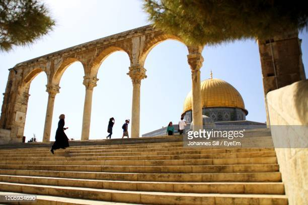 people at mosque against clear sky in jerusalem - jerusalem stock pictures, royalty-free photos & images