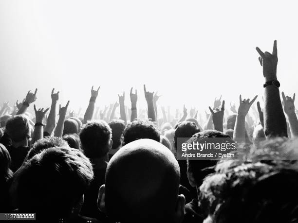 people at music concert - rock music stock pictures, royalty-free photos & images