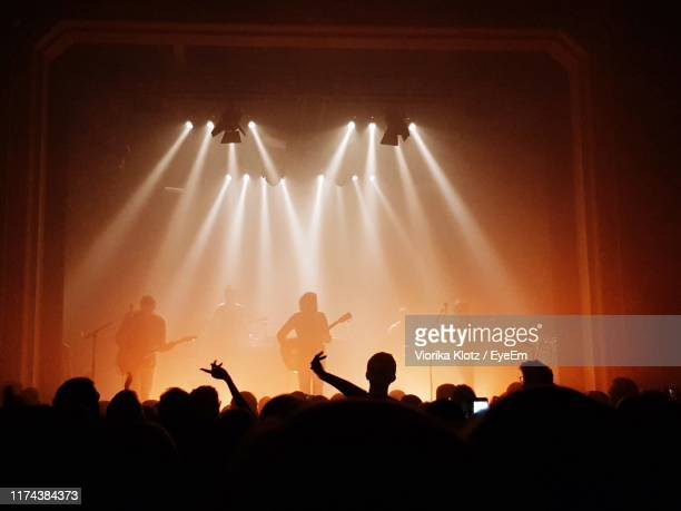 people at music concert - concert hall stock pictures, royalty-free photos & images