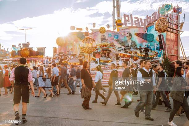 people at oktoberfest in munich, germany - theresienwiese stock pictures, royalty-free photos & images