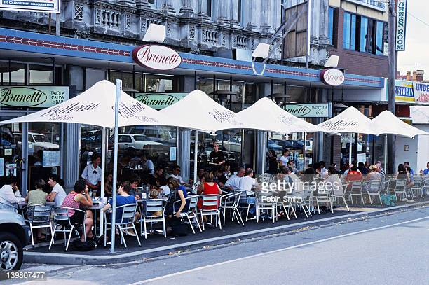 People at outdoor cafes in Faraday Street, Carlton, Melbourne, Victoria
