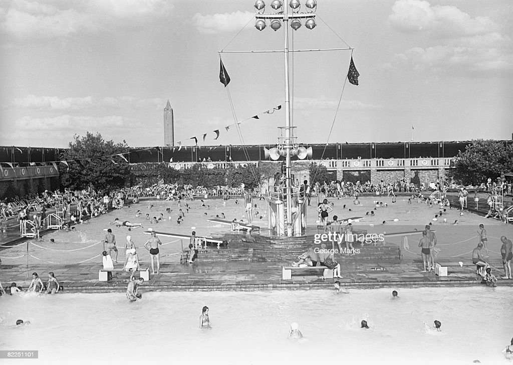 People at outdoor swimming pool, elevated view : Stock Photo