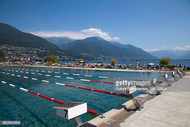 people at outdoor swimming pool, lido locarno, locarno, ticino, switzerland - locarno stock photos and pictures