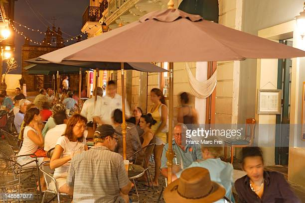 People at outdoor tables of cafe on Calle de Christo.
