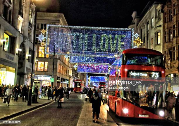 People at Oxford Circus walk under the newly erected Christmas Lights in Oxford Street. The iconic Oxford Street Christmas lights are now turned on...