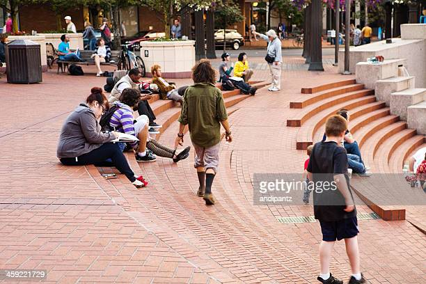 people at pioneer square - pioneer square portland stock photos and pictures