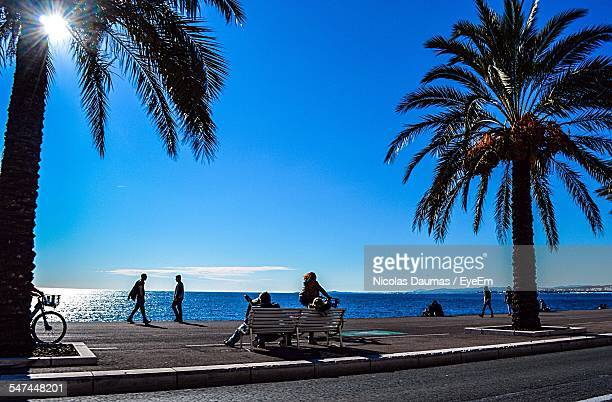 People At Promenade Des Anglais Against Blue Sky
