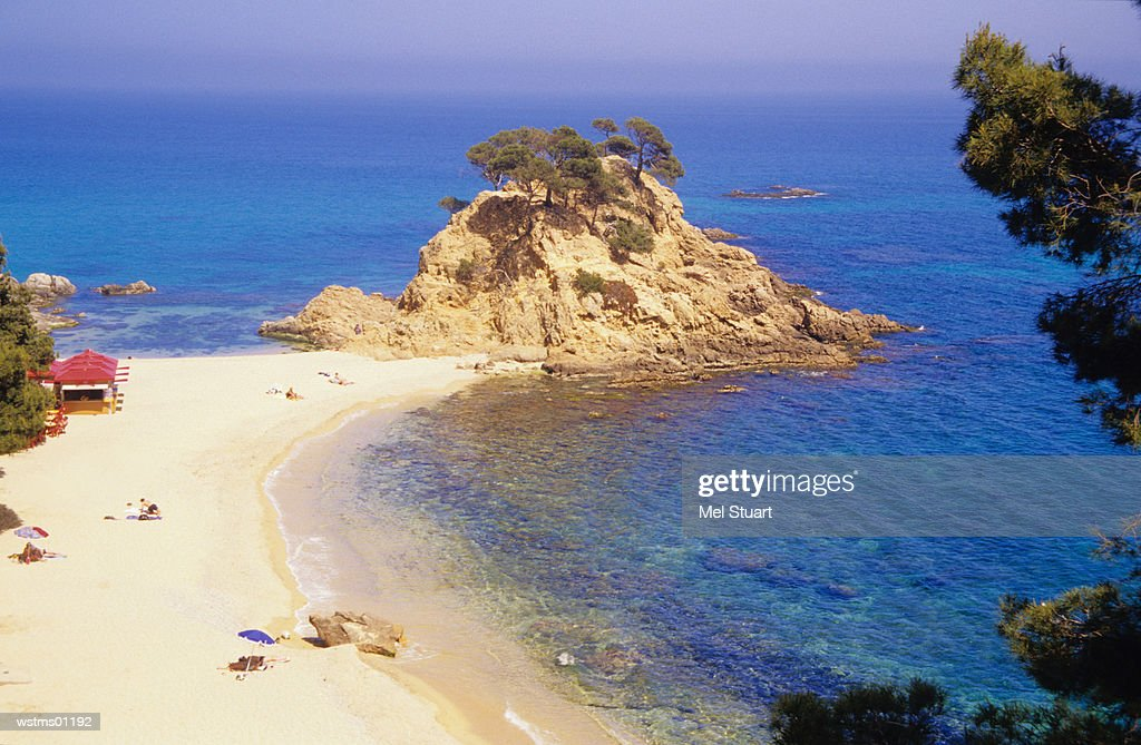 People at sandy beach, elevated view, Cap Roig, Platja de Cap Roig, North of Platja d'Aro, Costa Brava, Catalonia, Spain : Stock Photo