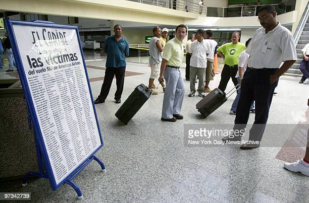 People at Santo Domingo's Las Americas International Airport gather around a list of victims of American Airlines flight 587 The Airbus A300 went...