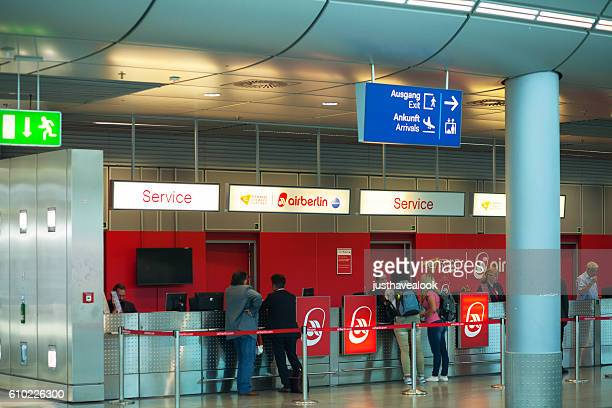 People at service counter of Air Berlin