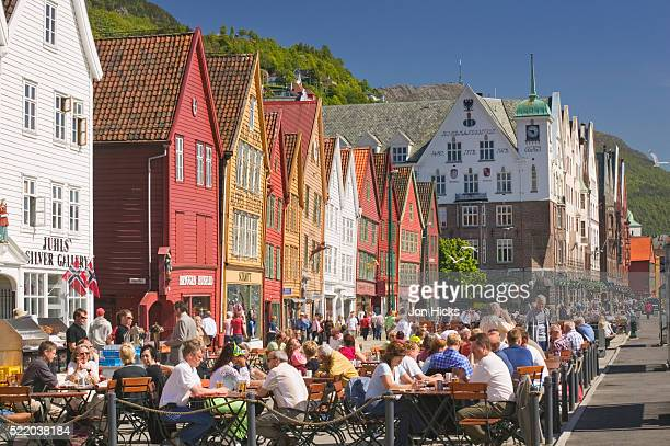people at sidewalk cafes in bergen - bergen norway stock pictures, royalty-free photos & images