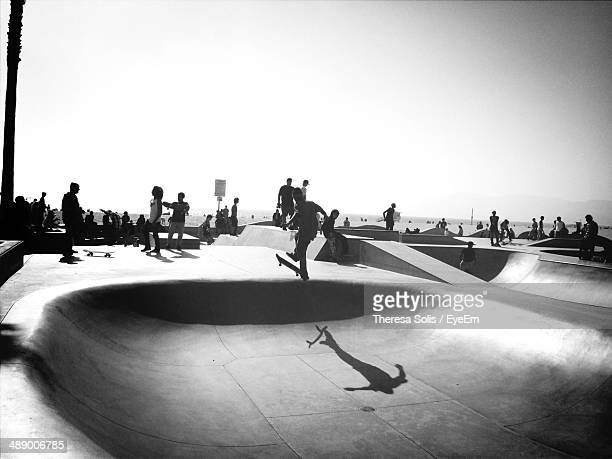 people at skateboarding park against clear sky - san fernando california stock photos and pictures