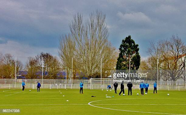 people at soccer field against cloudy sky - french football photos et images de collection