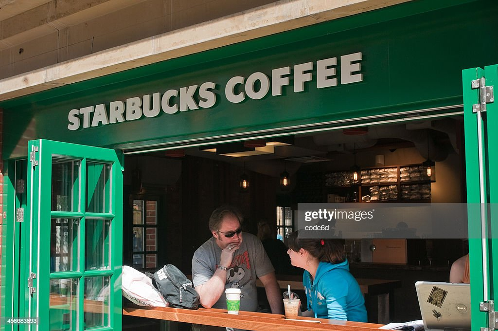 People At Starbucks Coffee House London Uk High Res Stock