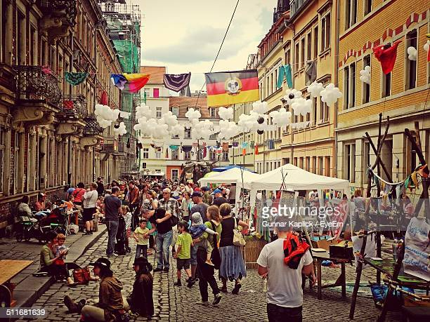 people at street market in city - chemnitz stock pictures, royalty-free photos & images
