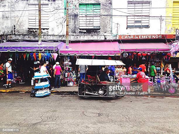 people at street market - merida mexico stock photos and pictures