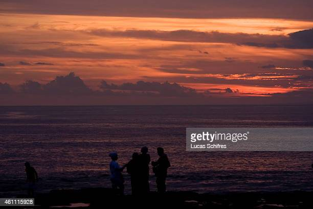 People at sunset on Tanah Lot temple on February 19 2010 in Bali Indonesia