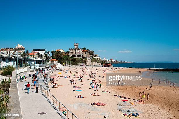 People at Tamariz beach with Estoril Castle
