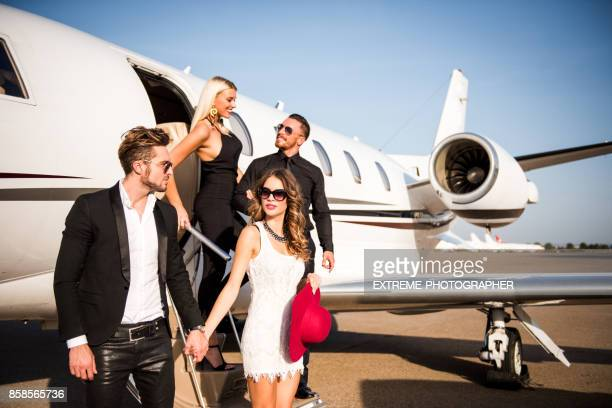 people at the airport - private aeroplane stock pictures, royalty-free photos & images