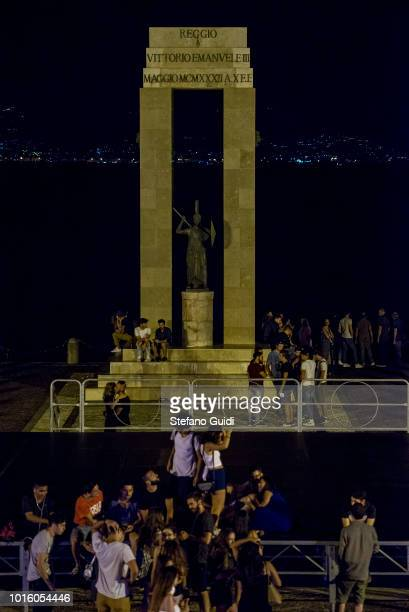 People at the Arena of the Strait of Reggio Calabria during the nightlife in the Via Marina The Via Marina of Reggio Calabria consists of the four...