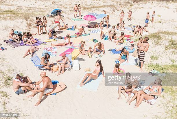 people at the beach. tarifa, cadiz, costa de la luz, andalusia, southern spain. - crowded beach stock pictures, royalty-free photos & images