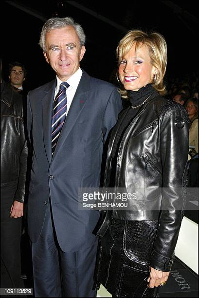 People At The Christian Dior SpringSummer 2004 ReadyToWear Show On October 8 2003 In Paris France Bernard Arnault And His Wife Helene