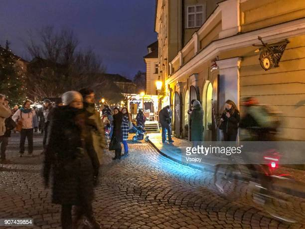people at the christmas food market, prague, czech republic - vsojoy stock pictures, royalty-free photos & images